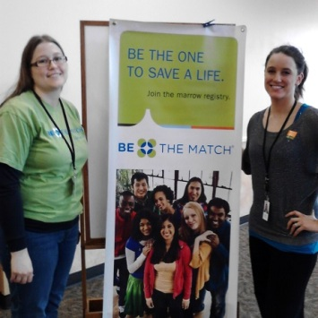 Women pose with banner for Be the Match registry